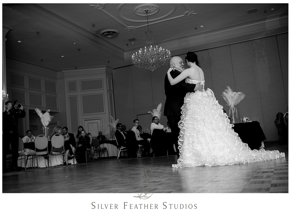 Madison dances with her grandfather on the ballroom floor of the Empire Room. Photographed by Ariana Watts of Silver Feather Studios, a Burlington, NC wedding photography and videography company.
