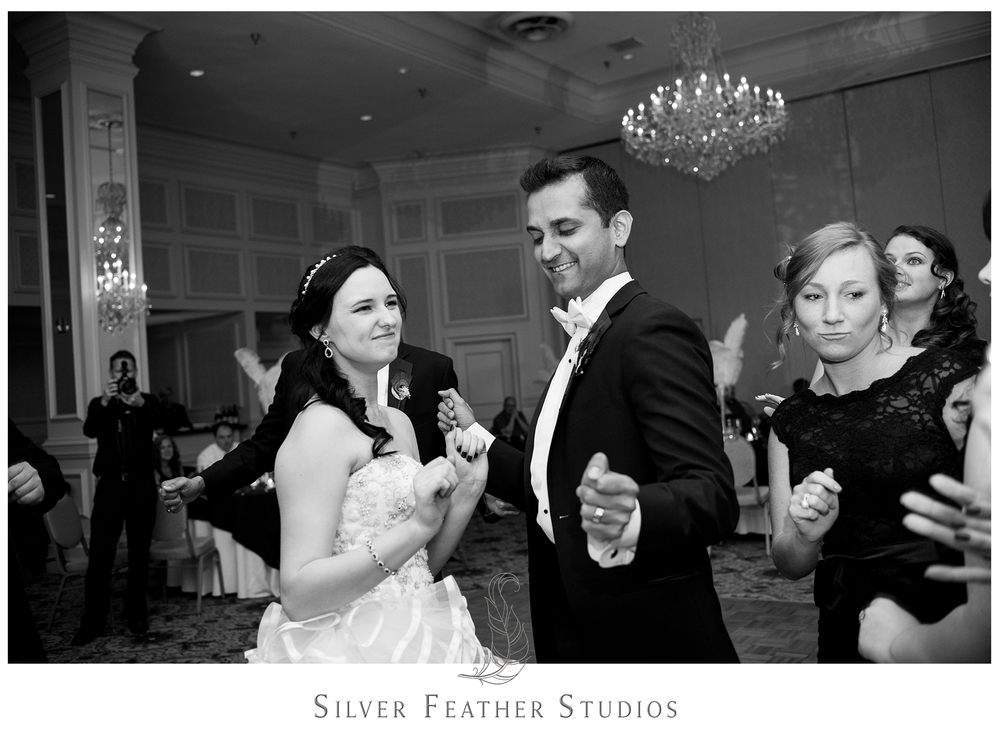 Ready to get down and dance at their reception in Greensboro, NC. Photographed by Ariana Watts of Silver Feather Studios, a Burlington, NC wedding photography and videography company.