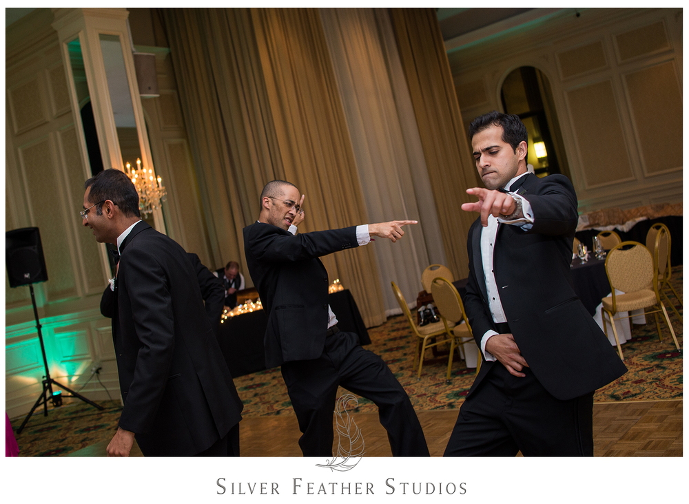 Dancing like Michael Jackson at this Empire Room wedding reception. Image by wedding photographers in Greensboro, Silver Feather Studios.