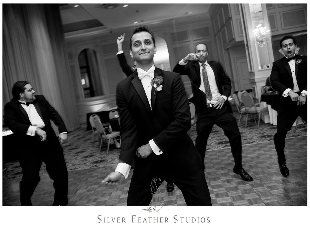 Empire Room wedding reception dancing with the groom and his friends. Photographed by Ariana Watts, Greensboro wedding photographer.