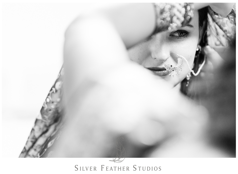 Madison wears a beautiful gold hoop earring at her Indian wedding in Raleigh.
