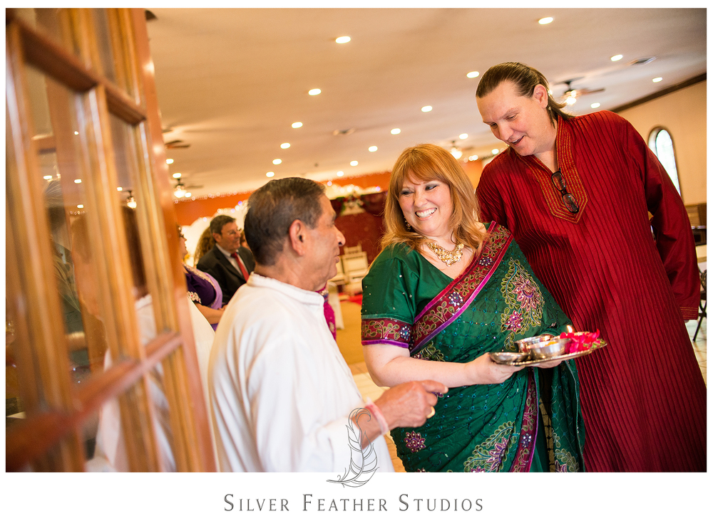 Parents of the bride wear the traditional Hindu garments at their daughter's Indian wedding.