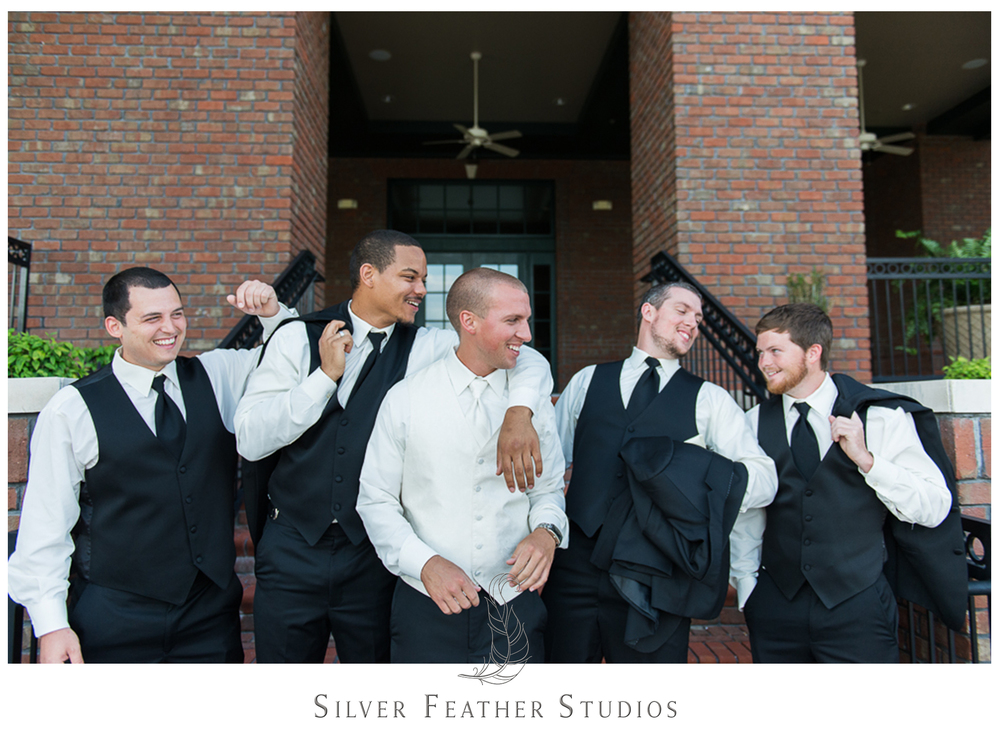 The guys laugh together with nerdy wedding photography company, Silver Feather Studios.