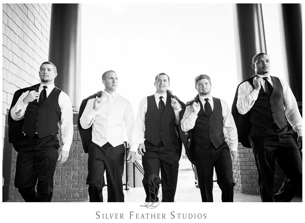 Grooms walk around like male models at Jay's River Landing wedding.