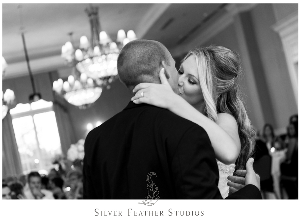 A special kiss. Photographed by Silver Feather Studios, a Burlington, NC wedding photography and videography company.