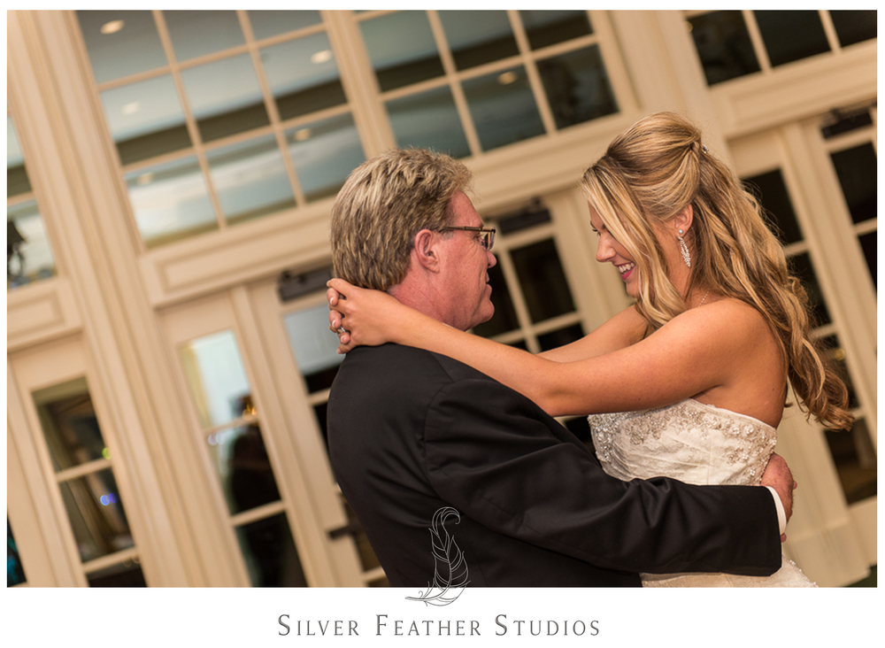 The father/daughter dance. Photographed by fun Burlington, NC wedding photographers.