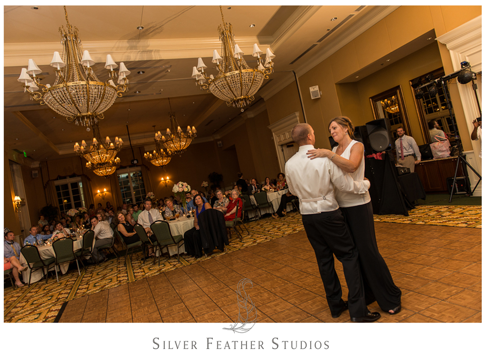 The mother and son dance in the River Landing ballroom in Wallace, NC.