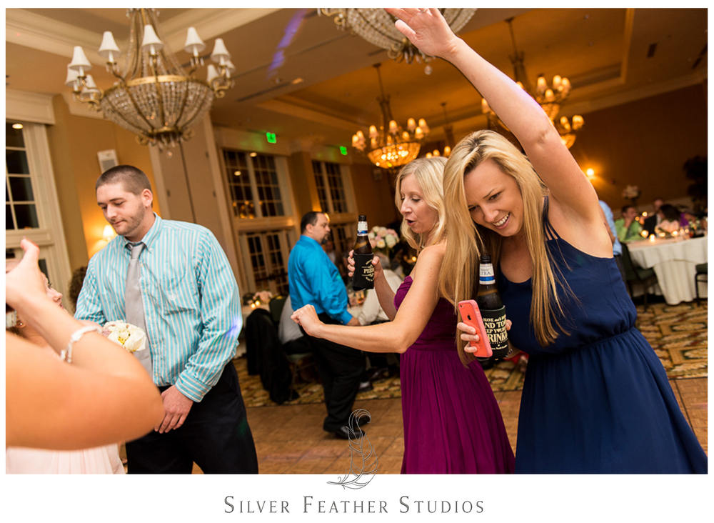 Wild dancing during Megan and Jay's River Landing wedding in Wallace.
