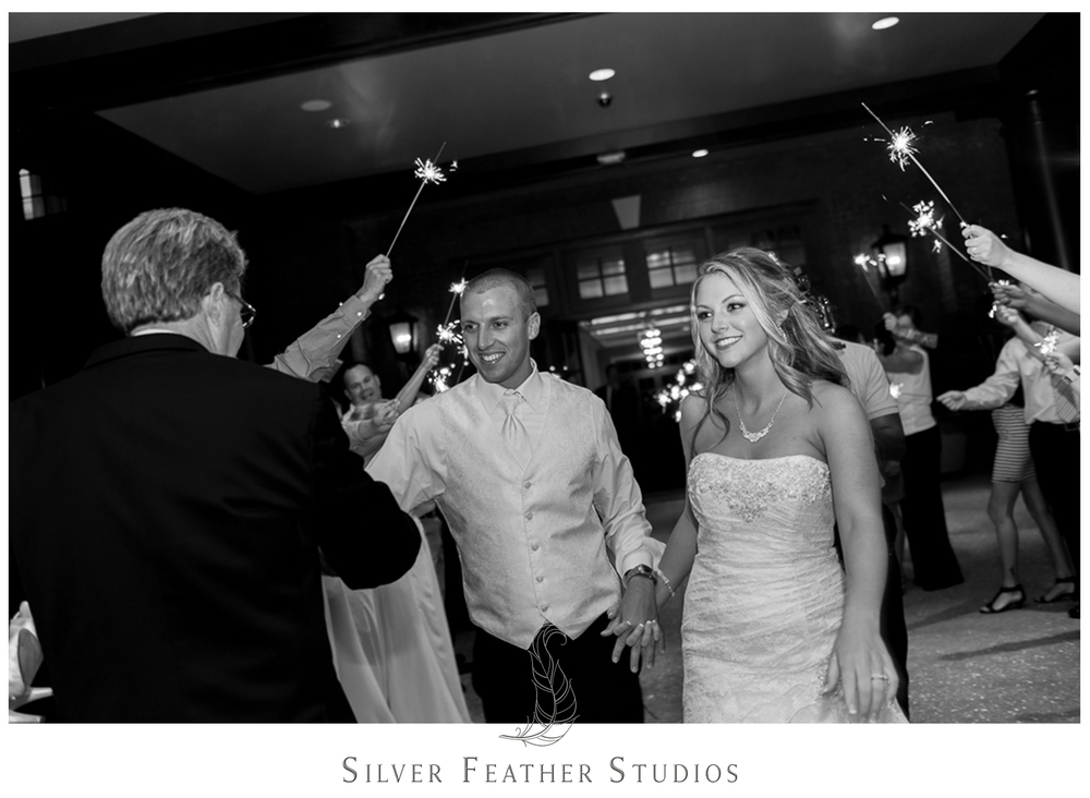 Sparkler exit. Documented by a Burlington, NC wedding photography and videography company, Silver Feather Studios.