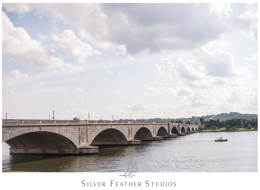 Gorgeous blue skies over the bridge to Arlington. © Silver Feather Studios, Burlington, NC wedding photographer