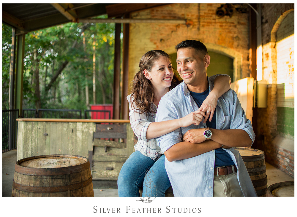 daniel and emily pose on barrels at their belt line station engagement session