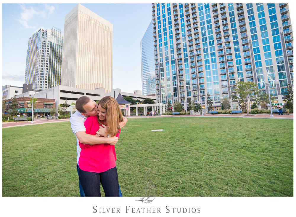 The Charlotte skyline makes a lovely backdrop for this fun engagement session by Silver Feather Studios.