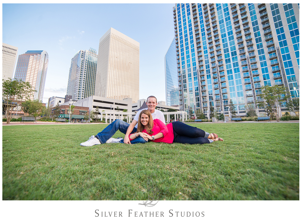 Charlotte engagement session shows off the skyline of Uptown Charlotte.