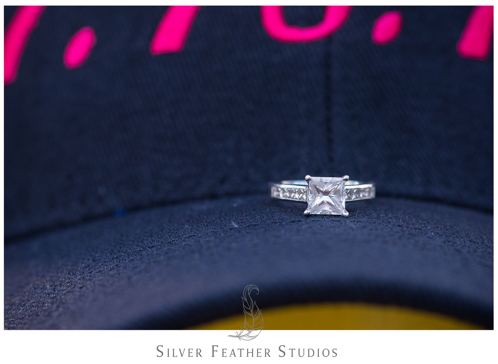 Stunning square cut engagement ring on a hat.