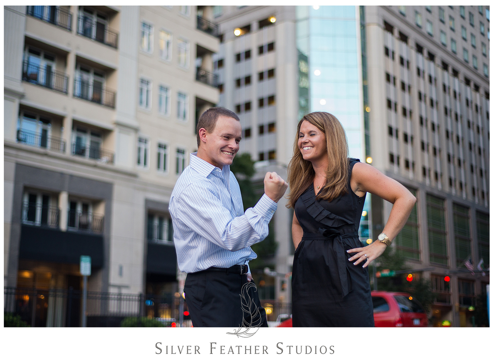 Engaged couple get silly at their engagement session with Silver Feather Studios.