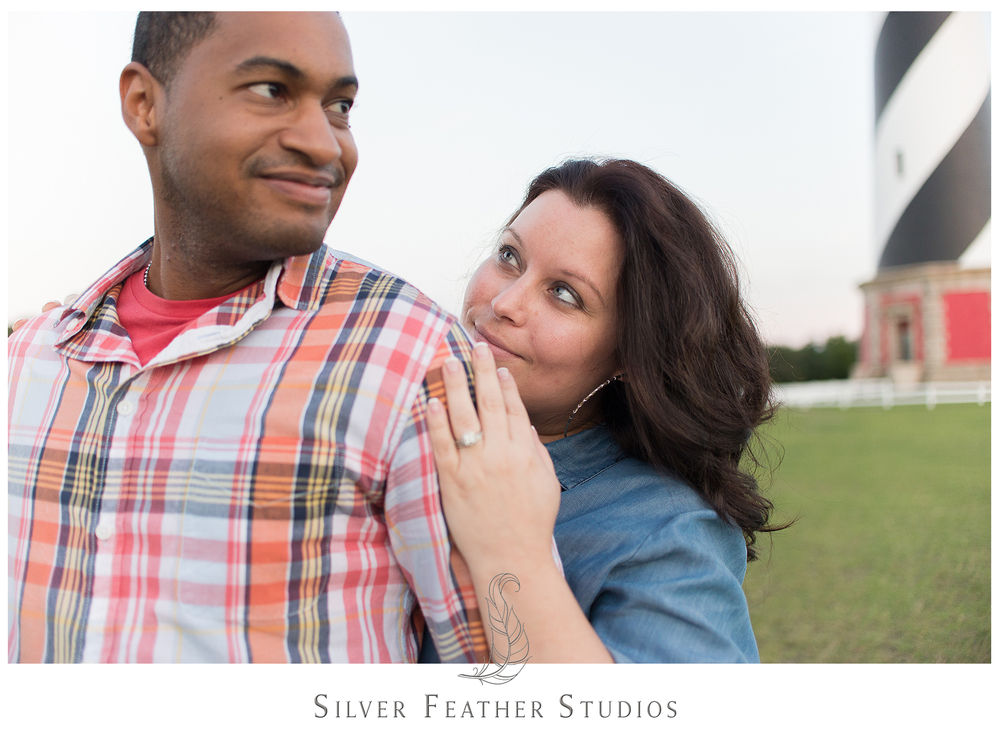 A couples portrait session at the Outer Banks by Burlington, NC wedding photographer, Silver Feather Studios.