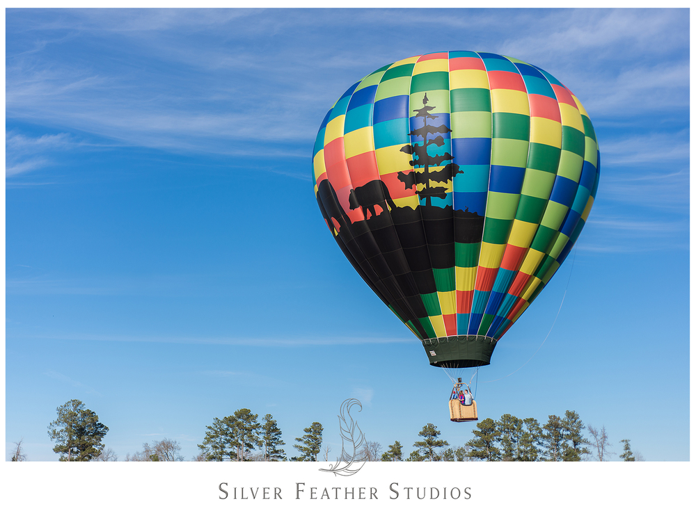 Hot air balloon engagement session in Benson, NC by Silver Feather Studios.