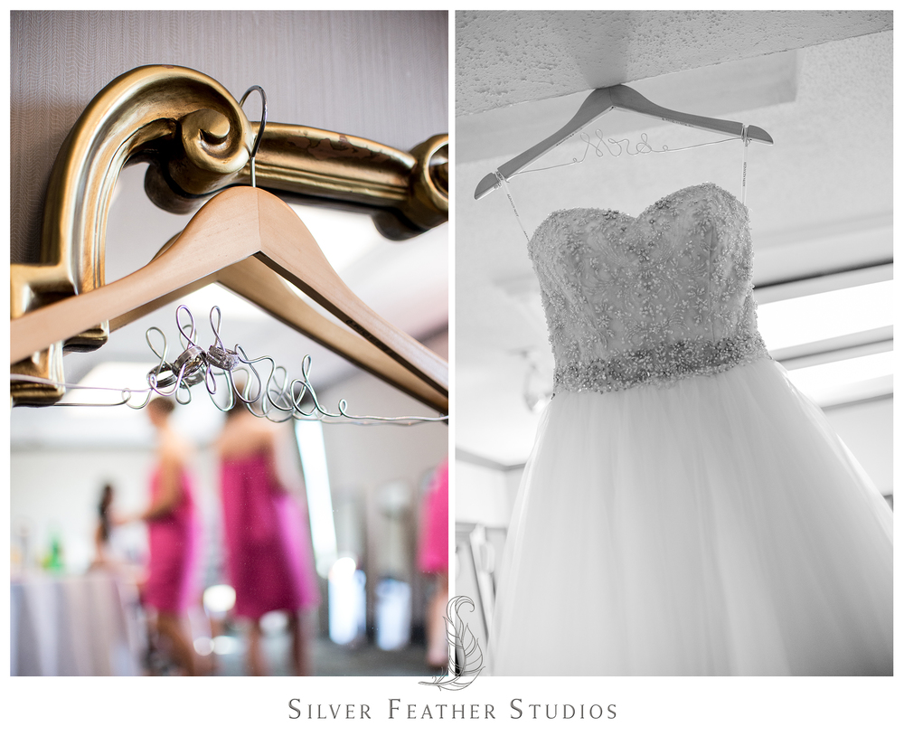 bride's wedding gown hangs at the hilton riverside in wilmington, nc. photography by silver feather studios.