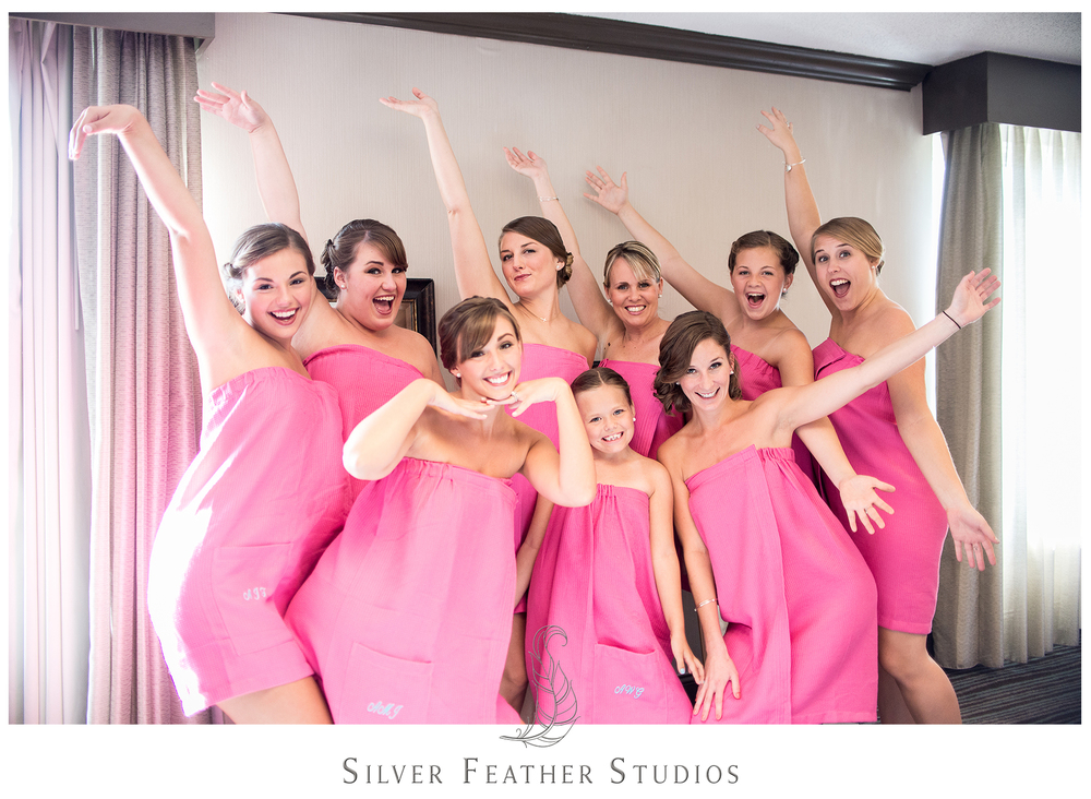 bridesmaids in pink robes at the hilton riverside. wilmington, nc wedding photography by silver feather studios.