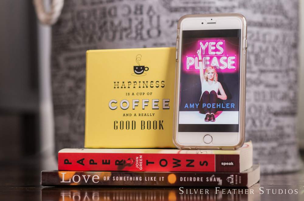 Books by Amy Poehler, John Green, and Deirdre Shaw, as photographed by Silver Feather Studios.