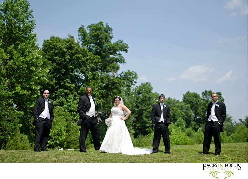The groomsmen pose on the lawn outside in North Carolina's 90 degrees
