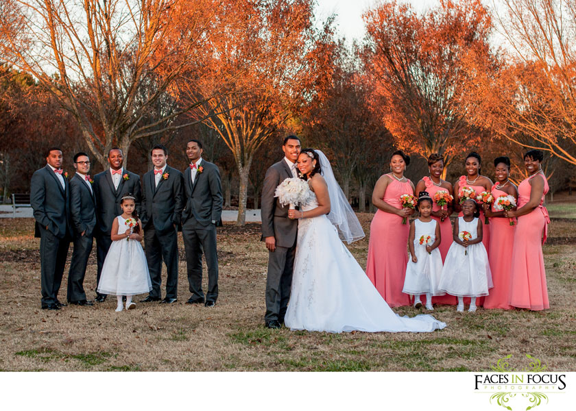 coral, orange, ivory wedding party pose at a park in durham, north carolina.