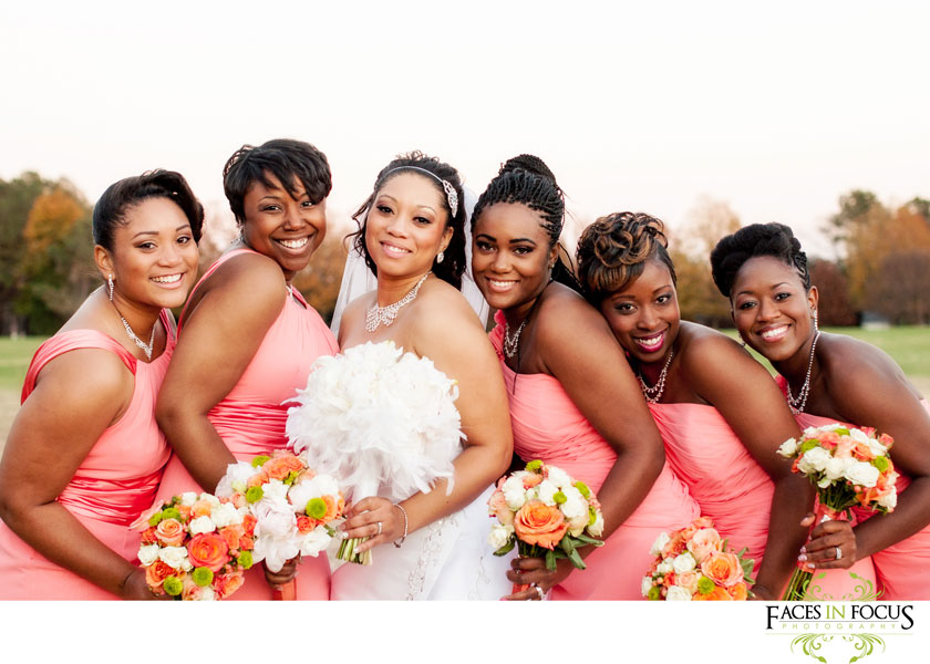 gorgeous coral bridesmaid dresses, orange and ivory bouquets. © silver feather studios, wedding photographer in durham, nc.