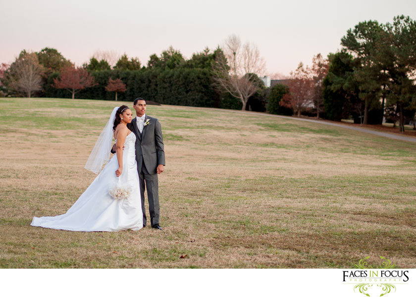 briana and chris together in a field on their wedding day in Durham, nc.