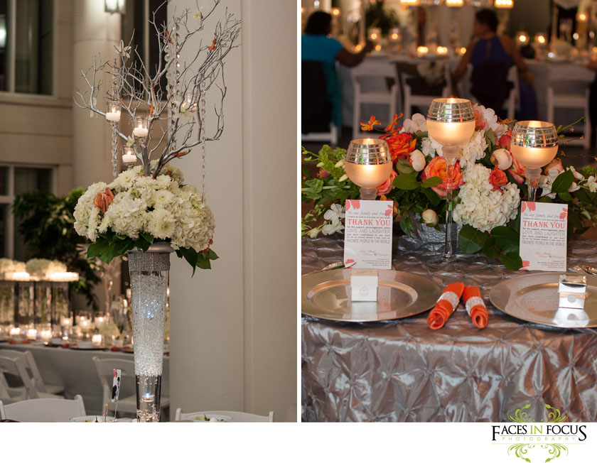 tall centerpieces filled with ivory and orange flowers, branches and hanging candles set the scene for briana and chris' duke north pavilion wedding reception in durham.