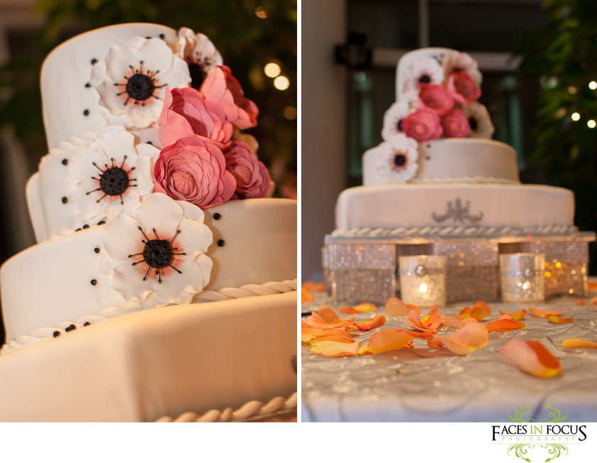 beautiful four tier wedding cake with faux flowers and orange petals. duke north pavilion wedding in durham, nc.