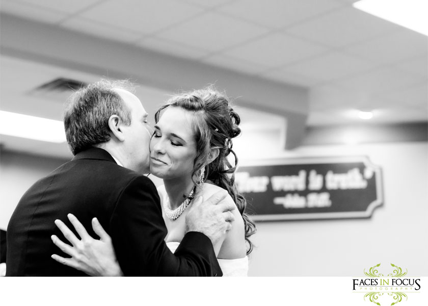 Graham Wedding - Father kisses bride walking down the aisle.