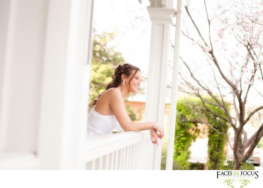 Bride poses on porch of Alamance Arts Council