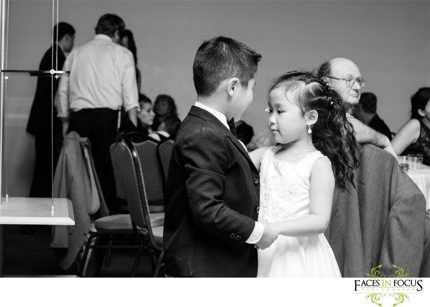 Ring bearer and flower girl dance together at The Palladium