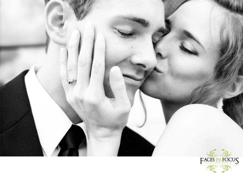 Sweet kiss on cheek in Graham, North Carolina by Graham Photographer