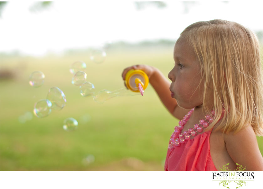 Emma plays with bubbles.