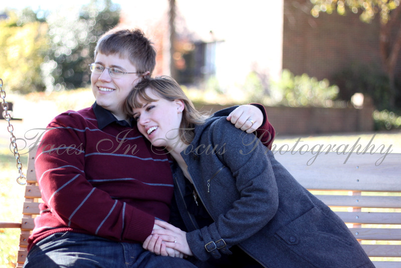 Elon University students cuddle on bench