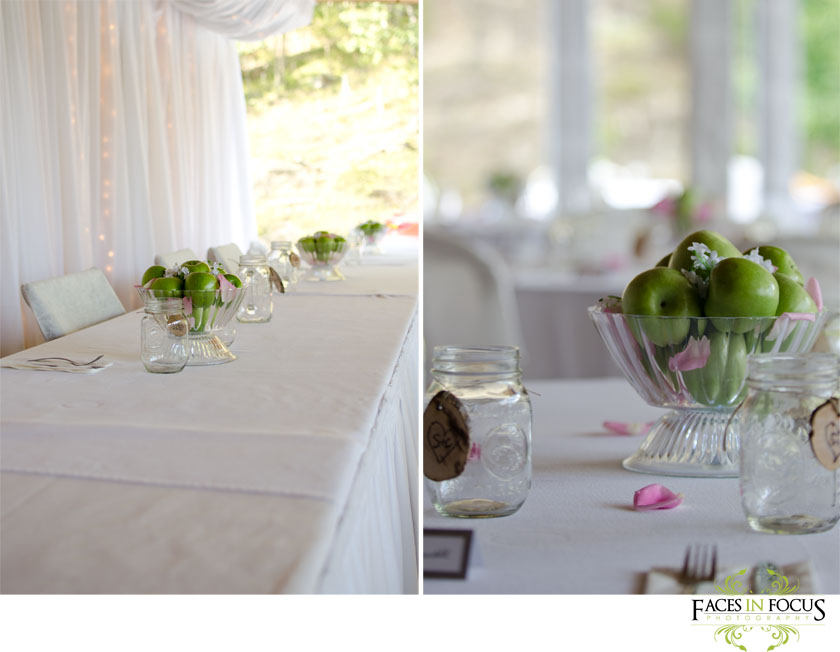 White table cloths with green apple centerpieces.