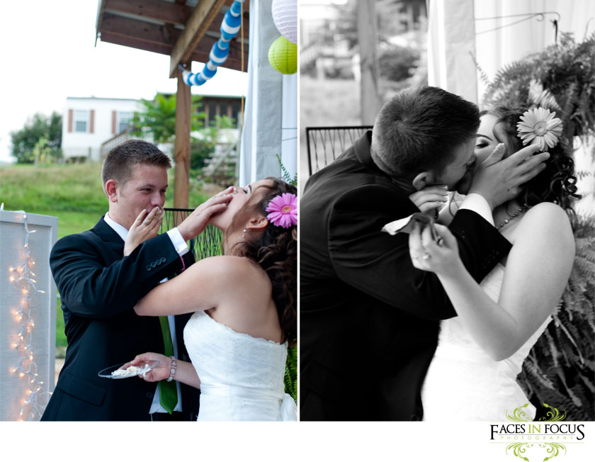 Bride and groom smash the cake in each others faces.