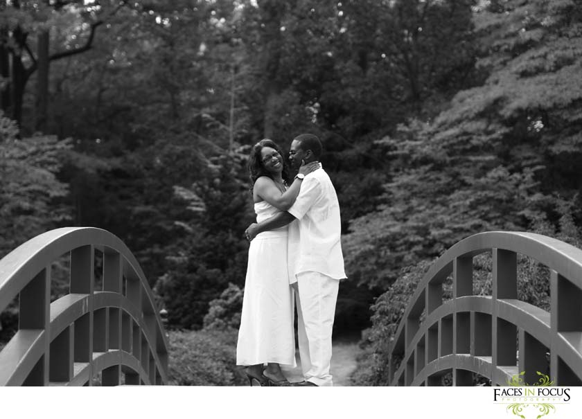 Duke Gardens - Two laughing people in love on Duke Gardens Bridge