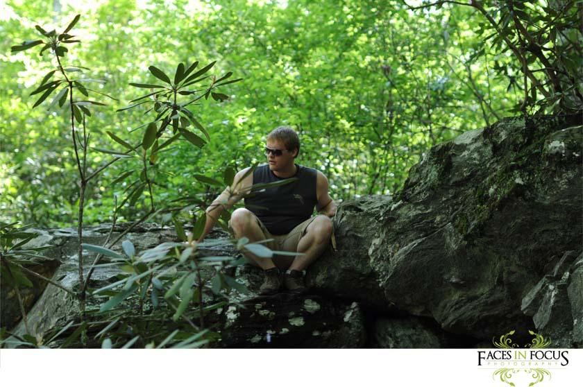 Jared climbs the rocks