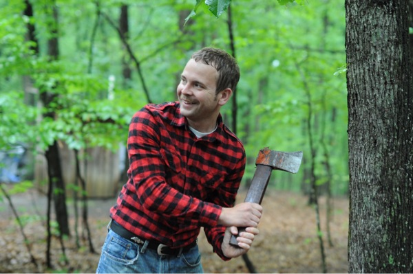 Brandon pretends to chop a tree with his mini-axe