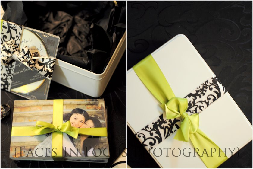 Ribbon-wrapped photos and packaged CDs by Burlington NC Wedding Photographer