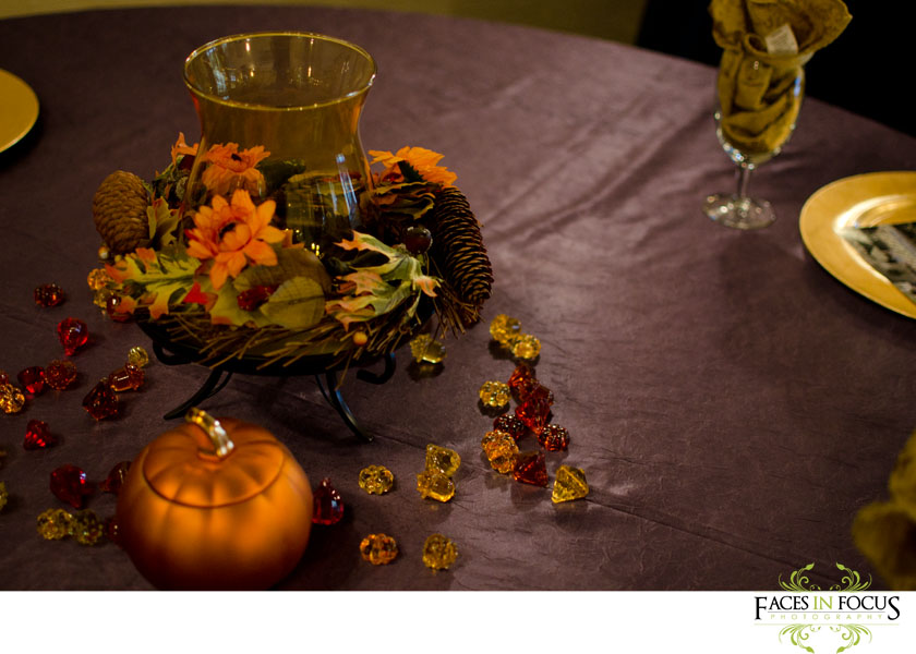 Beautiful fall leaf arrangements array the purple table cloth.
