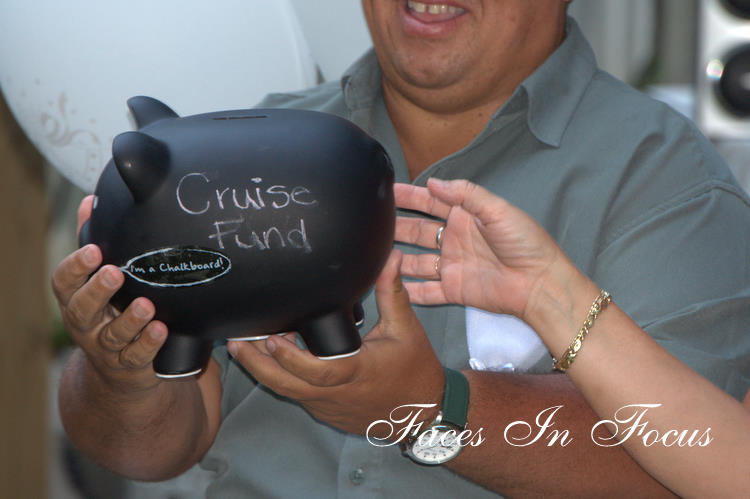 A chalkboard piggy bank was given as an anniversary gift with the words Cruise Fund.