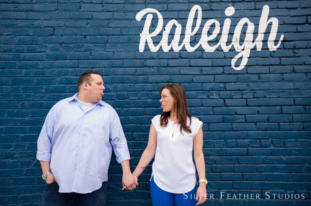 engagement session in downtown raleigh, nc by silver feather studios, north carolina wedding videographer.