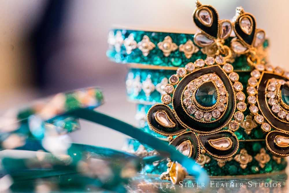 Macro photography of the bride's hindu details for her reception outfit at The Cotton Room. © Silver Feather Studios, wedding photographer in Durham, NC.