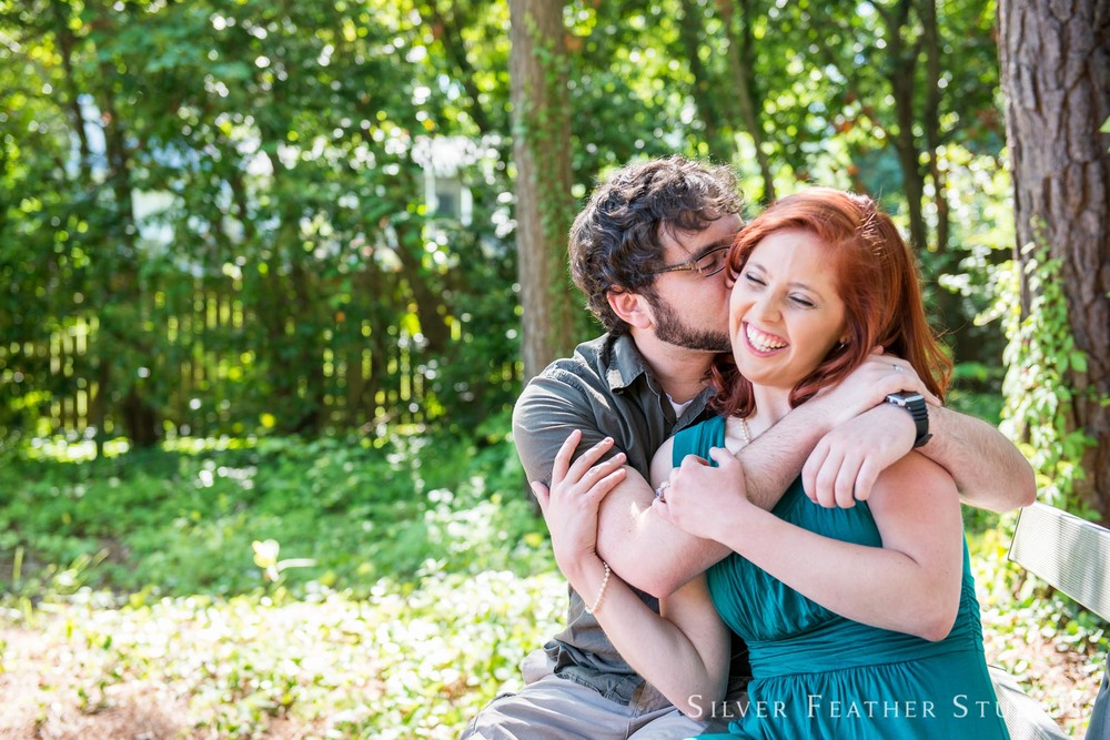 Kenari and Brian cuddle together for their geeky engagement session in Durham, North Carolina. © Silver Feather Studios, geeky wedding photographer in North Carolina.