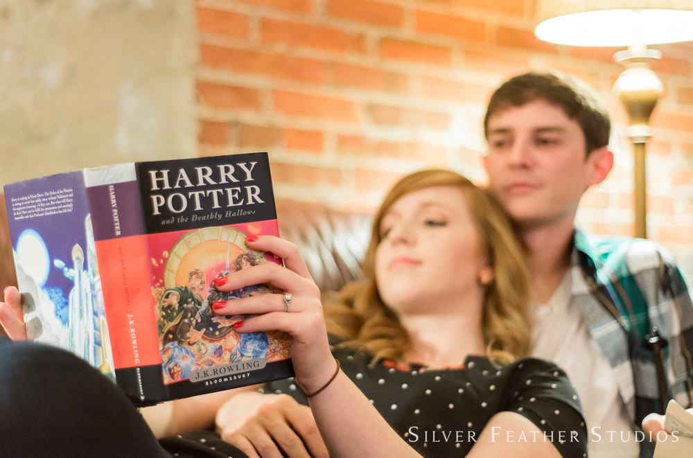 Harry Potter book at this geeky engagement session by geeky wedding photographer in Burlington, NC, Silver Feather Studios