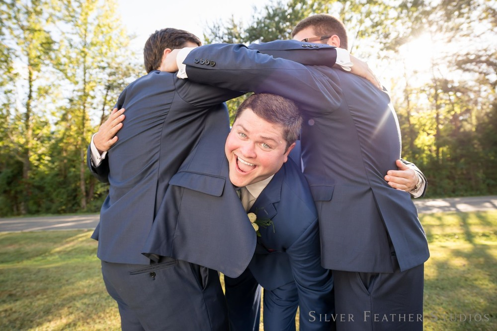 Fun groomsmen photos by wedding photographer in North Carolina, Silver Feather Studios
