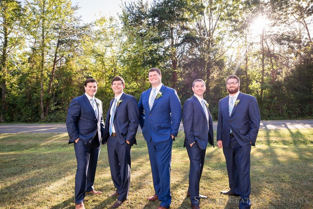 Navy suits on groomsmen at this countryside wedding in Blanch by wedding photographer in North Carolina, Silver Feather Studios.